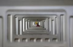 An employee works at a Chinese automobile factory in Hefei, Anhui province, March 15, 2014.  REUTERS/Stringer