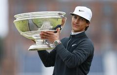 Golf - Alfred Dunhill Links Championship - St. Andrews, Scotland - 4/10/15 Denmark's Thorbjorn Olesen celebrates with the trophy after winning the Alfred Dunhill Links Championship Mandatory Credit: Action Images / Jason Cairnduff Livepic