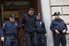 NBA player Thabo Sefolosha, 30, of the Atlanta Hawks is seen escorted out of the 10th Precinct of the New York Police Department (NYPD) in Manhattan, New York on April 8, 2015.   REUTERS/Andrew Kelly