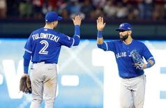 Oct 11, 2015; Arlington, TX, USA; Toronto Blue Jays shortstop Troy Tulowitzki (2) celebrates with right fielder Jose Bautista after defeating the Texas Rangers in game three of the ALDS at Globe Life Park in Arlington. Mandatory Credit: Tim Heitman-USA TODAY Sports
