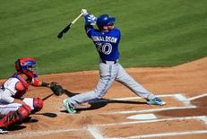 Oct 12, 2015; Arlington, TX, USA; Toronto Blue Jays third baseman Josh Donaldson (20) hits a home run against the Texas Rangers during the first inning in game four of the ALDS at Globe Life Park in Arlington. Mandatory Credit: Kevin Jairaj-USA TODAY Sports