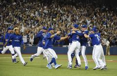 Oct 14, 2015; Toronto, Ontario, CAN; Toronto Blue Jays players celebrate on the field after defeating the Texas Rangers in game five of the ALDS at Rogers Centre. Mandatory Credit: Peter Llewellyn-USA TODAY Sports