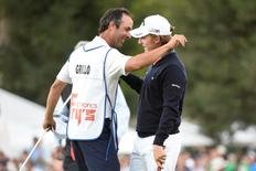 Emiliano Grillo (right) hugs caddie Jose Luis Campras (left) after winning the Frys.com Open at Silverado Country Club. Kyle Terada-USA TODAY Sports