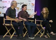 """Actors Christopher Lloyd (l), Michael J Fox (c) and Lea Thompson (r) attend a media conference for the 30th anniversary of their film """"Back to the Future"""" at the London Film and Comic-Con in London, Britain July 17, 2015. REUTERS/Neil Hall - RTX1KQPJ"""