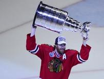 Jun 15, 2015; Chicago, IL, USA;  Chicago Blackhawks defenseman Duncan Keith (2) hoist the Stanley Cup after defeating the Tampa Bay Lightning in game six of the 2015 Stanley Cup Final at United Center. Mandatory Credit: David Banks-USA TODAY Sports