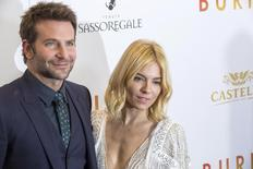 """Cast members Bradley Cooper and Sienna Miller arrive for the premiere of the film """"Burnt"""" in New York October 20, 2015. REUTERS/Lucas Jackson"""