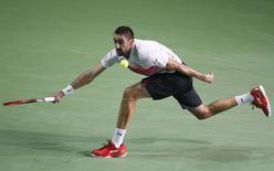 Marin Cilic of Croatia hits a return against Roberto Bautista Agut of Spain during their Kremlin Cup men's single tennis match final in Moscow, Russia, October 25, 2015. REUTERS/Sergei Karpukhin -
