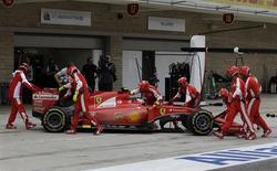 Mechanics push Ferrari's Kimi Raikkonen, of Finland, back into the team garage during the Formula One U.S. Grand Prix auto race at the Circuit of the Americas, Sunday, Oct. 25, 2015, in Austin, Texas.REUTERS/Darron Cummings/POOL