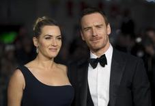 """Cast members Kate Winslet and Michael Fassbender pose for photographers at the closing night premiere of the film """"Steve Jobs""""at the BFI London Film Festival October 18, 2015. REUTERS/Neil Hall"""