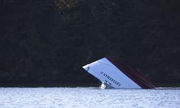 Capsized whale watching boat Leviathan 2 sits in a bay after being towed from where it sank in Tofino, British Columbia October 26, 2015. REUTERS/Kevin Light
