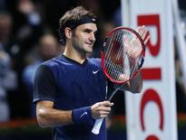 Roger Federer of Switzerland celebrates after defeating Philipp Kohlschreiber of Germany at the Swiss Indoors ATP men's tennis tournament in Basel, Switzerland October 29, 2015.   REUTERS/Arnd Wiegmann