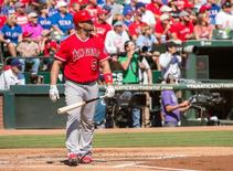 Oct 4, 2015; Arlington, TX, USA; Los Angeles Angels designated hitter Albert Pujols (5) watches his two run home run clear the fences against the Texas Rangers during the first inning at Globe Life Park in Arlington. Mandatory Credit: Jerome Miron-USA TODAY Sports