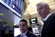 Activist investor Bill Ackman (R) speaks with specialist trader Michael Cacace, at the post where Valeant Pharmaceuticals International Inc. is traded  on the floor of the New York Stock Exchange November 10, 2015. REUTERS/Brendan McDermid  -