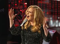 """British singer Adele performs the song """"Skyfall"""" from the film """"Skyfall,"""" nominated as best original song, at the 85th Academy Awards in Hollywood, California February 24, 2013.     REUTERS/Mario Anzuoni/Files"""