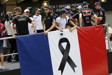 Formula One drivers participate in a parade in tribute to the victims of the Paris attacks, before the Brazilian F1 Grand Prix in Sao Paulo, Brazil, November 15, 2015.  REUTERS/Nacho Doce