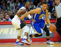 Nov 19, 2015; Los Angeles, CA, USA; Golden State Warriors guard Stephen Curry (30) drives to the basket past Los Angeles Clippers guard Chris Paul (3) in the first half of the game at Staples Center. Mandatory Credit: Jayne Kamin-Oncea-USA TODAY Sports