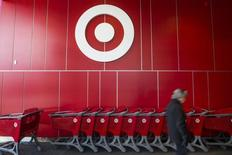 A man walks by shopping carts during the going-out-of-business sale at Target Canada in Toronto, February 5, 2015. REUTERS/Mark Blinch