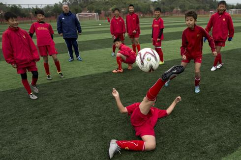 Teaching the beautiful game in China