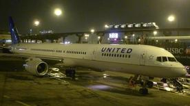 A United Airlines airplane painted in its new corporate logo sits at a gate at Liberty International Airport in Newark, New Jersey, February 7, 2011.  REUTERS/Gary Hershorn