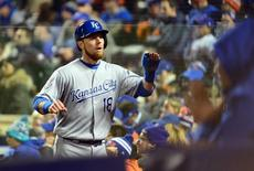 Oct 31, 2015; New York City, NY, USA; Kansas City Royals second baseman Ben Zobrist (18) celebrates with teammates after scoring a run against the New York Mets in the sixth inning in game four of the World Series at Citi Field. Mandatory Credit: Jeff Curry-USA TODAY Sports
