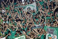 Panathinaikos' fans cheer during game against CSKA Moscow at their Euroleague Final Four semifinal basketball game in Istanbul May 11, 2012.  REUTERS/Murad Sezer