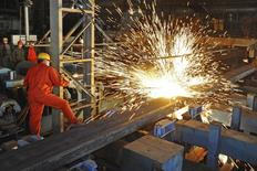 An employee works at a factory of Dongbei Special Steel Group Co., Ltd., in Dalian, Liaoning province, China, December 5, 2015. REUTERS/China Daily