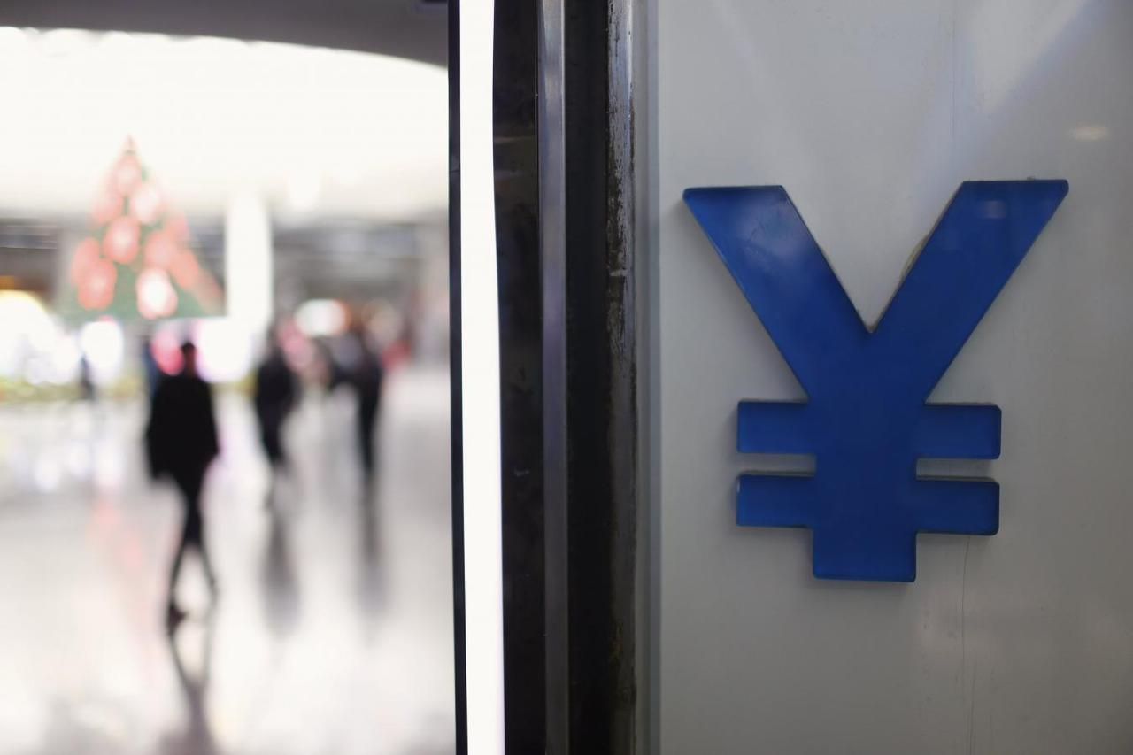 China launches new yuan index to sway markets away from yuan dollar a logo of yuan is seen at a foreign exchange store in shanghai china december 1 2015 reutersaly song buycottarizona Gallery