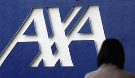 Axa est l'une des valeurs à suivre à la Bourse de Paris après que l'annonce du groupe de la finalisation du rachat de la filiale d'assurance des grands risques du groupe brésilien SulAmérica pour 135 millions de reals. /Photo d'archives/REUTERS/Mick Tsikas