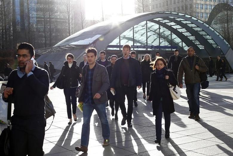 Workers leave the underground station at the Canary Wharf business district in London February 26, 2014.  REUTERS/Eddie Keogh