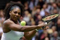 Serena Williams of the U.S. plays against Caroline Wozniacki of Denmark in their Champions Battle exhibition tennis match in Herning, Denmark November 26, 2015. REUTERS/Claus Fisker/Scanpix Denmark