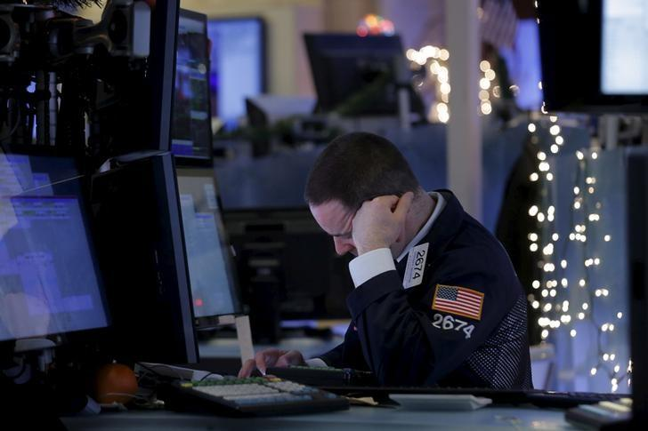 A specialist trader works at his post on the floor of the New York Stock Exchange in New York, January 6, 2016. REUTERS/Brendan McDermid