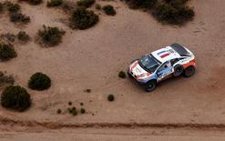 The Mitsubishi of Lionel Baud of France is seen on the side of the road during the seventh stage in the Dakar Rally 2016 near Uyuni, Bolivia, January 9, 2016. REUTERS/Marcos Brindicci