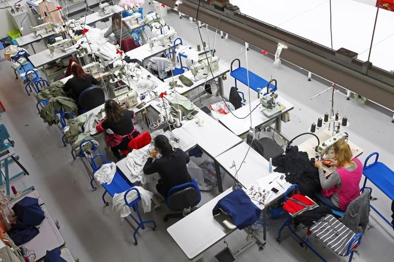 Women work on sewing machines at the Fashion Enter factory in London England, January 8, 2016. REUTERS/Eddie Keogh