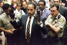 O.J. Simpson holds up his hands to the jury in this June 15, 1995 file photo. The case is all set to get a TV adaptation.