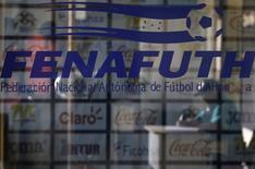 A security guard is seen inside the National Football Federation head office of Honduras (FENAFUTH), in Tegucigalpa, Honduras December 3, 2015. REUTERS/Jorge Cabrera