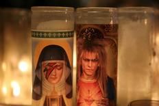 Candles are seen at a memorial for deceased musician David Bowie outside his former residence in the Manhattan borough of New York January 14, 2016. REUTERS/Andrew Kelly