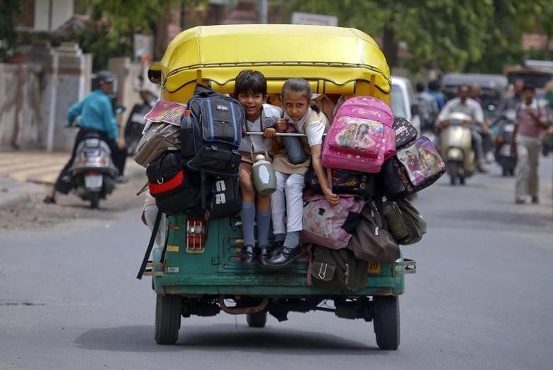 School children pack a auto-rickshaw on their way to school in Ahmedabad July 20, 2011. REUTERS/Amit Dave/Files