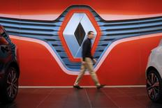 A man walks in front of a Renault logo at a dealership in Saint-Herblain near Nantes, January 19, 2016. REUTERS/Stephane Mahe