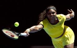 Serena Williams of the U.S. reaches for a shot during her first round match against Italy's Camila Giorgi at the Australian Open tennis tournament at Melbourne Park, Australia, January 18, 2016. REUTERS/Jason Reed