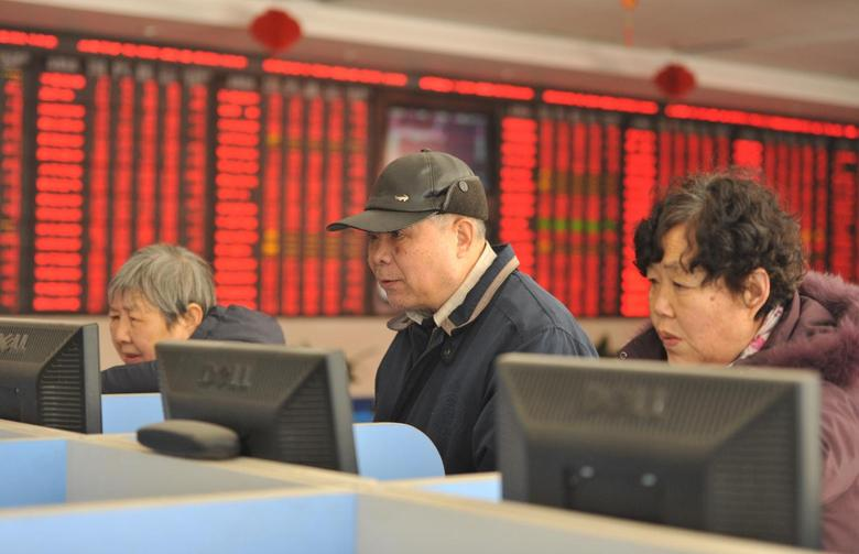 Investors look at computer screens showing stock information at a brokerage house in Fuyang, Anhui province, January 19, 2016. REUTERS/China Daily