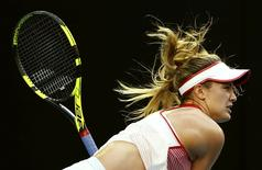 Canada's Eugenie Bouchard serves during her second round match against Poland's Agnieszka Radwanska at the Australian Open tennis tournament at Melbourne Park, Australia, January 20, 2016. REUTERS/Thomas Peter       TPX IMAGES OF THE DAY