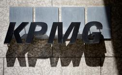 The logo of financial services company KPMG is seen on a building in Toronto June 11, 2015. REUTERS/Chris Helgren