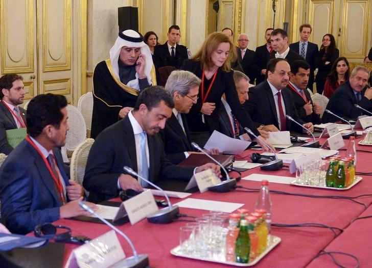 Saudi Arabia's Foreign Minister Adel Al-Jubeir (3rd L, standing) walks up to talk with U.S. Secretary of State John Kerry at the start of a ministerial meeting on Syria at the Quai d'Orsay, Ministry of Foreign Affairs, in Paris December 14, 2015.  REUTERS/Mandel Ngan/Pool