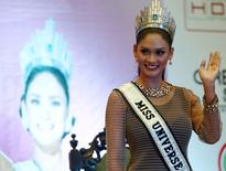 Miss Universe 2015 Pia Wurtzbach waves during a news conference at a hotel in Quezon city, metro Manila January 24, 2016, after her return to the Philippines.  REUTERS/Romeo Ranoco