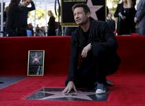 Actor David Duchovny poses on his star after it was unveiled on the Hollywood Walk of Fame in Los Angeles, California January 25, 2016.   REUTERS/Mario Anzuoni
