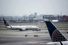 United Airlines planes are seen on platform at the Newark Liberty International Airport in New Jersey, July 8, 2015. REUTERS/Eduardo Munoz