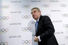 International Olympic Committee (IOC) President Thomas Bach leaves after a news conference in Lausanne, Switzerland, December 10, 2015. REUTERS/Denis Balibouse -