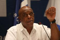Tokyo Sexwale  gestures during a news conference in the West Bank city of Jericho December 16, 2015.  REUTERS/Mohamad Torokman