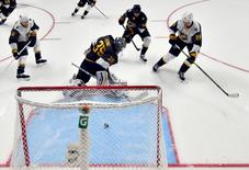 Jan 31, 2016; Nashville, TN, USA; Pacific Division forward John Scott (28) of the Montreal Canadiens scores a goal past Central Division goaltender Pekka Rinne (35) of the Nashville Predators during the 2016 NHL All Star Game at Bridgestone Arena. Mandatory Credit: Christopher Hanewinckel-USA TODAY Sports
