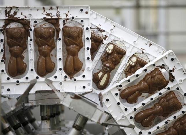 Chocolate easter bunnies come off the production line at the Thorntons chocolate factory in Alfreton, Britain, May 5, 2015. REUTERS/Phil Noble/Files